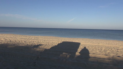 morning empty sea resort beach with shadows