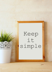 "white drawing board with the phrase "" keep it simple"" written on"