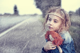Orphan in the winter snowy day sitting alone outdoors poster