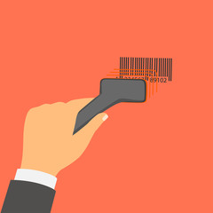 Hand holds a barcode scanner