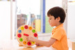 Little boy learning time with clock toy of montessori