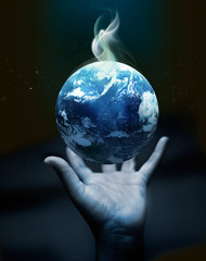 Holding earth on hand - Original image from NASA