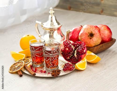 Fotobehang Marokko Traditional arabic tea with metal teapot and fruits