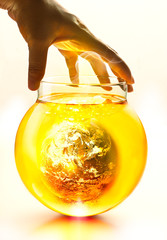 Earth burning in the bottle and yellow water boil under hand