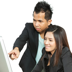 Business partners working at the office on a computer
