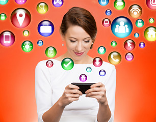 woman using smart phone multimedia icons flying out of screen