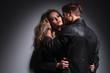 Blond fashion man kissing his lover