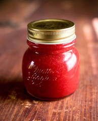 Red currant jam in a jar