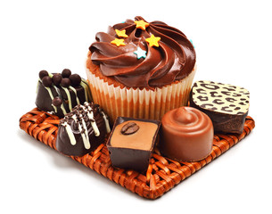 Chocolate muffin with chocolate sweets, candies isolated