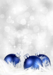 Christmas or holiday background with blue and silver ornaments