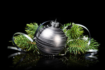 Christmas ornament with fir branches on a black background