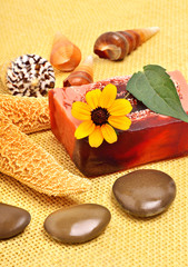 Handmade natural soap, shells and pebbles