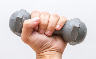 Left hand hold small dumbbell.