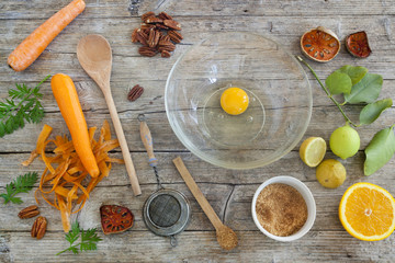 fruits and vegetables ingredients on wooden table with utensils