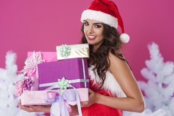 Beautiful santa claus with christmas presents