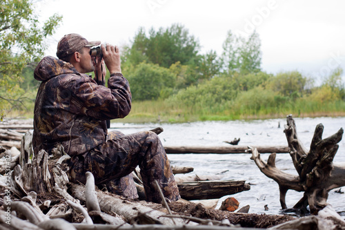 man with binoculars in the hunt - 72537482