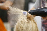 Fototapety Hairstylist Drying Hair Blonde in Salon
