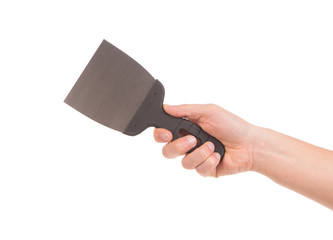Hand holds construction spatula.