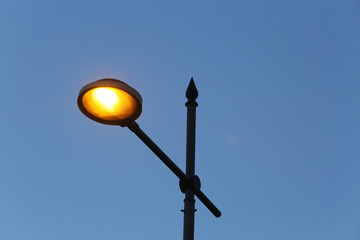 A Lighted Street Lamp and Sky at Sunset