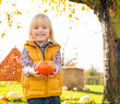 Portrait of happy child with pumpkin