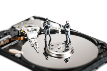 Soldiers protecting computer hard drive. Technology concept.