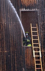Fireman extinguish a fire with a hose