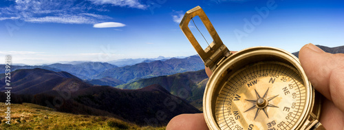 Leinwanddruck Bild compass in the mountains