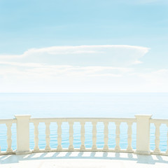 balcony over sea and light clouds in blue sky