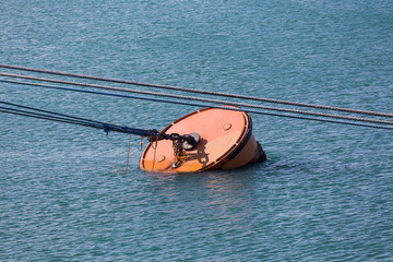 Metal Barrel Mooring in Blue Water