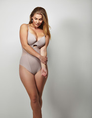 Attractive plus size young lady in body stocking