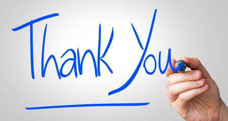 Thank You hand writing with a blue mark on a transparent board