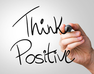 Think Positive hand writing with a black mark