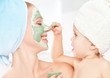 family beauty treatment . mother and daughter make mask