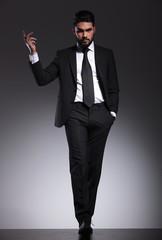 Elegant business man walking forward