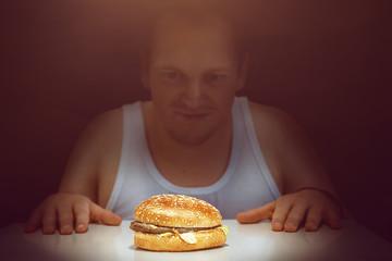 Guy stares at his burger