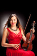 Vertical shot of a female violinist posing