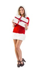 Pretty santa girl standing with gift