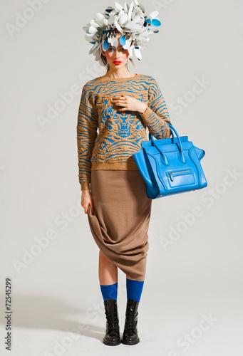 Fashion model pose on light background - 72545299
