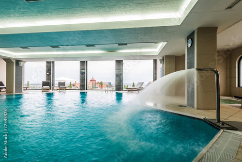 Leinwanddruck Bild Indoor swimming pool hotel
