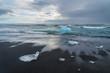 Icebergs on a black sand Jokulsarlon beach, Iceland