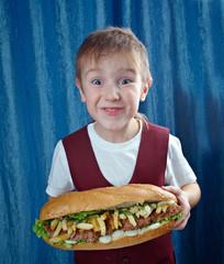 Boy eating big sandwiches
