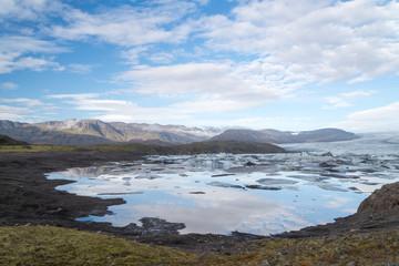 Scenic view of wild Icelandic landscape with ice lagoon.