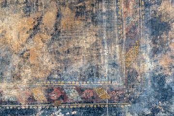 Ragged fresco in Pompeii, Italy
