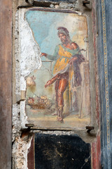Roman fresco depicting the god Priapus in Pompeii, Italy