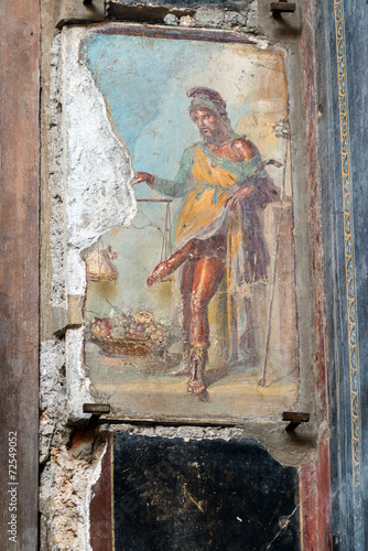 Roman fresco depicting the god Priapus in Pompeii, Italy - 72549052