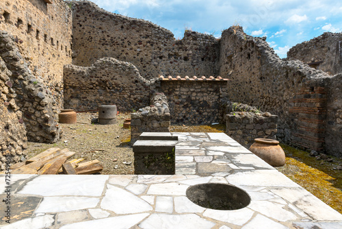 Ruins of an ancient bar  in Pompeii, Italy