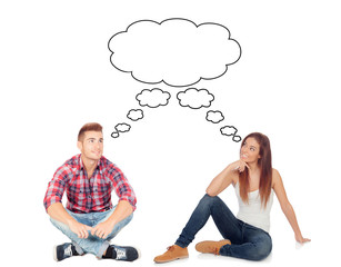 Casual couple sitting on the floor isolated