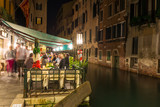 Night view of canal and restaurant in Venice, Italy - Fine Art prints
