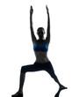 woman exercising yoga warrior position silhouette