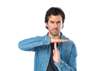 Man making time out gesture over white background